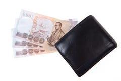 Schwarze lederne Mappe mit Geld lizenzfreie stockfotografie
