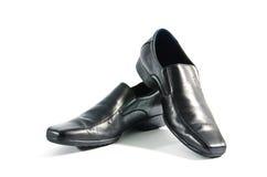 Schwarze lederne Schuhe stockbild