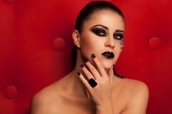 Schwarze Lippen und Augen der Mode lizenzfreie stockfotografie