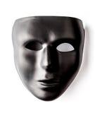 Schwarze Maske auf weißem Hintergrund Stockbild