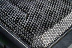 Schwarze Metallcomputerkasten-Plattenmasche mit Lochbeschaffenheit Stockbilder