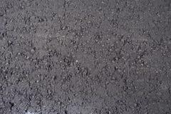 Schwarze neue Asphalt layerasphalt Straßendecke - Straßenbau Lizenzfreie Stockfotos