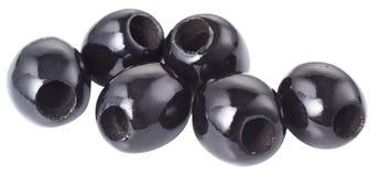 Schwarze Oliven auf Weiß Stockbilder