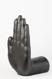 Schwarze Pflasterhand gegen weißen Hintergrund Stockfoto
