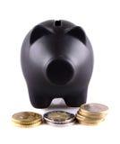 Schwarze piggy Querneigung mit Euromünzen Lizenzfreies Stockfoto