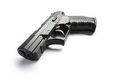 Schwarze Pistole auf Weiß Stockfotografie