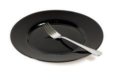 Schwarze Platte und Gabel Stockfoto