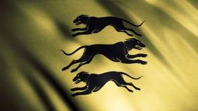 Schwarze Schattenbilder von drei Hunden, die in verschiedene Richtungen auf goldenen wellenartig bewegenden Flaggenhintergrund, n lizenzfreies stockbild