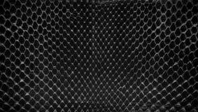 Schwarze Schlangenhaut, abstrat lederne Beschaffenheit für Hintergrund Lizenzfreies Stockfoto