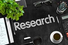 Schwarze Tafel mit Forschungs-Konzept Wiedergabe 3d Stockbilder