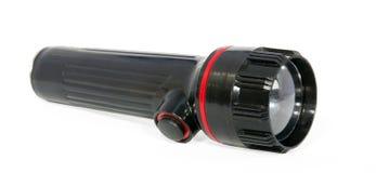 Schwarze Taschenlampe stockfoto