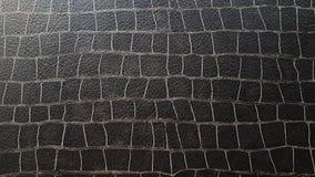 Schwarze Tierhautbeschaffenheit oder -hintergrund stockbild