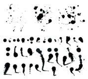 Schwarze Tintenspraytropfen lokalisiert auf weißem Hintergrund Lizenzfreies Stockbild