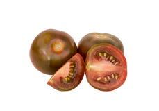 schwarze Tomaten lizenzfreie stockfotografie