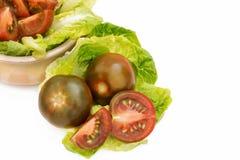 schwarze Tomaten stockbilder