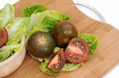 schwarze Tomaten lizenzfreies stockbild
