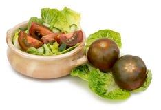 schwarze Tomaten lizenzfreie stockbilder