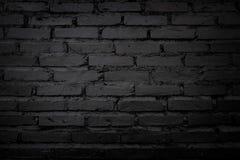 Schwarze und alte Backsteinmauer für Hintergrund Lizenzfreies Stockbild
