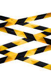 Schwarze und gelbe Vorsicht gestreifte Bänder lokalisiert Lizenzfreie Stockbilder