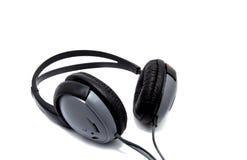 Schwarze und graue Kopfhörer lokalisiert auf weißem Hintergrund Lizenzfreie Stockfotografie