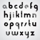 Schwarze verdrehte grafische Kleinbuchstaben, industrieller Guss Stockfotos