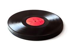 Schwarze Vinylplatte gegen weißen Hintergrund Stockfoto