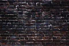 Schwarze Wände des Hintergrundes, dunkle Ziegelsteinbeschaffenheit für Design Stockbild