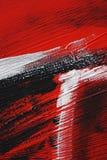 Schwarze, weiße, rote Acrylfarbe auf Metalloberfläche brushstroke Stockfoto