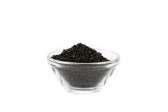 Schwarze Zwiebelenstartwerte für zufallsgenerator in der Glasschüssel Stockfoto
