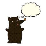 schwarzer Bär der lustigen Karikatur mit Gedankenblase Stockbild