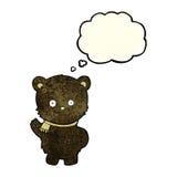 schwarzer Bär der netten Karikatur, der mit Gedankenblase wellenartig bewegt Stockbilder
