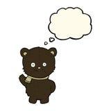 schwarzer Bär der netten Karikatur, der mit Gedankenblase wellenartig bewegt Stockbild
