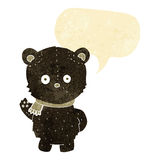 schwarzer Bär der netten Karikatur, der mit Spracheblase wellenartig bewegt Lizenzfreies Stockfoto