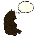 schwarzer Bär der netten Karikatur mit Gedankenblase Stockfotos
