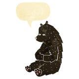 schwarzer Bär der netten Karikatur mit Spracheblase Stockfoto