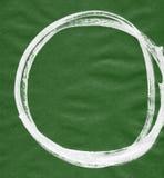 Schwarzer Bürstenanschlag in Form eines Kreises Zeichnung hergestellt in der handgemachten Technik der Tintenskizze Lizenzfreies Stockfoto