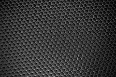 Schwarzer Bienenwabenhintergrund stockfotos