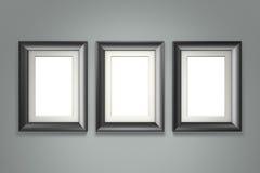 Schwarzer Bilderrahmen auf grauer Wand Stockfoto