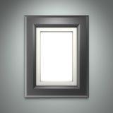Schwarzer Bilderrahmen auf grauer Wand Stockfotos