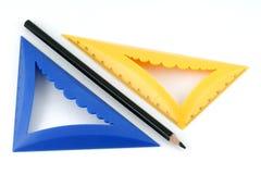 Schwarzer Bleistift und farbige Dreiecke Stockfotografie