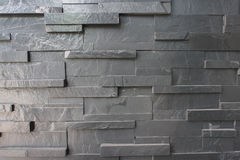 Schwarzer Block-Steinwand Stockfotografie