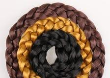 Schwarzer, blonder und brauner Haar-Zopf Lizenzfreie Stockfotos
