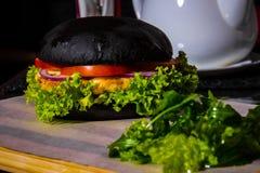 Schwarzer Burger Stockfoto