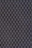 Schwarzer dekorativer Polyester-Gewebebeschaffenheitshintergrund, Abschluss oben Lizenzfreie Stockfotografie
