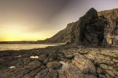 Schwarzer Felsen Luz Beach stockfoto