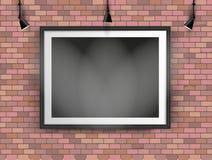 Schwarzer Fotorahmen auf Backsteinmauer Stockbilder