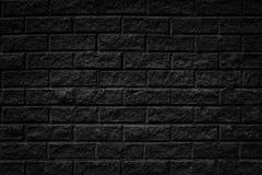 Schwarzer gebrochener alter rauer Ziegelstein deckt Wandhintergrund mit Ziegeln Lizenzfreies Stockfoto