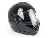 Schwarzer, glänzender Motorradsturzhelm Lizenzfreies Stockfoto
