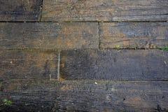 schwarzer hölzerner nasser Boden Stockbild