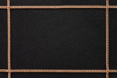 Schwarzer Hintergrund mit goldener Kette Lizenzfreie Stockbilder